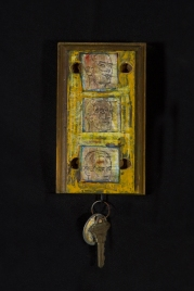 "Key Code Acrylics/mediums, image transfers, glass slides, staple, found keys/tag on found wood 9"" x 3 ½"" x 1"""